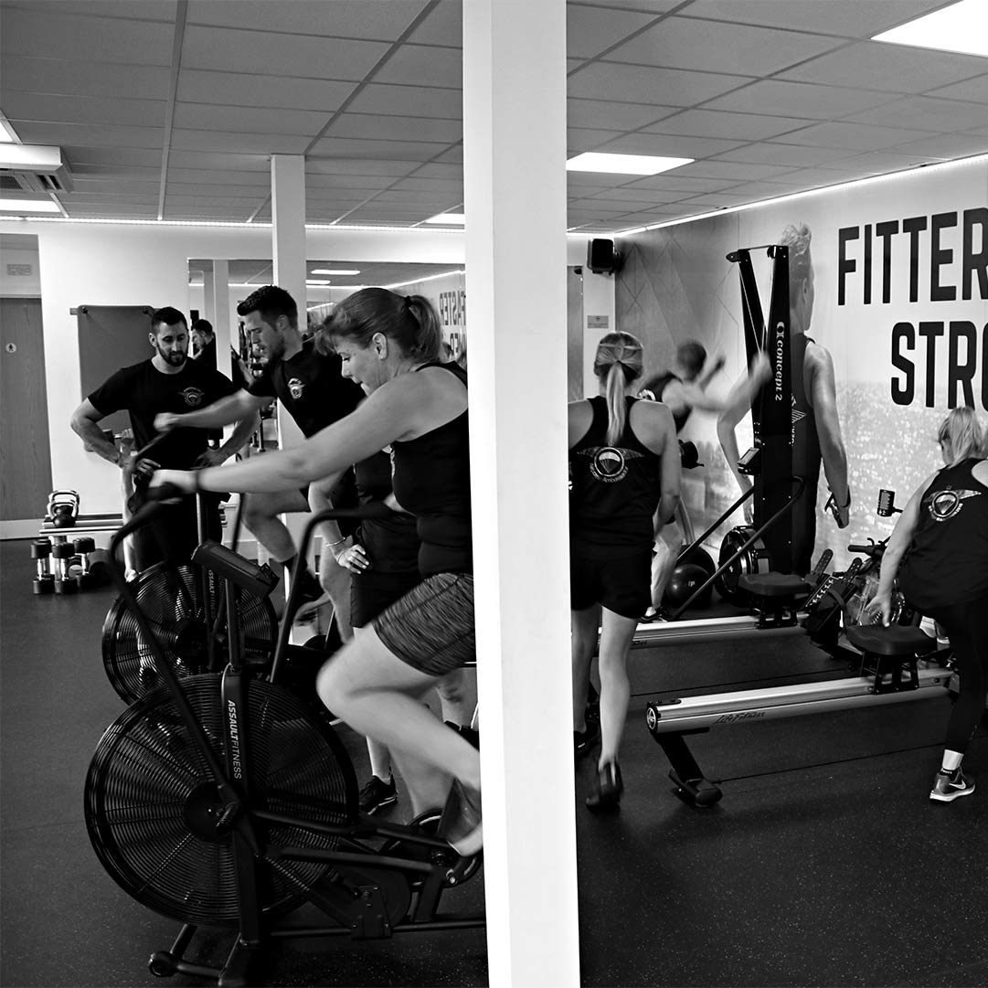 Men and Women in Airborne Fit sportswear using the functional fitness equipment at Brightwell