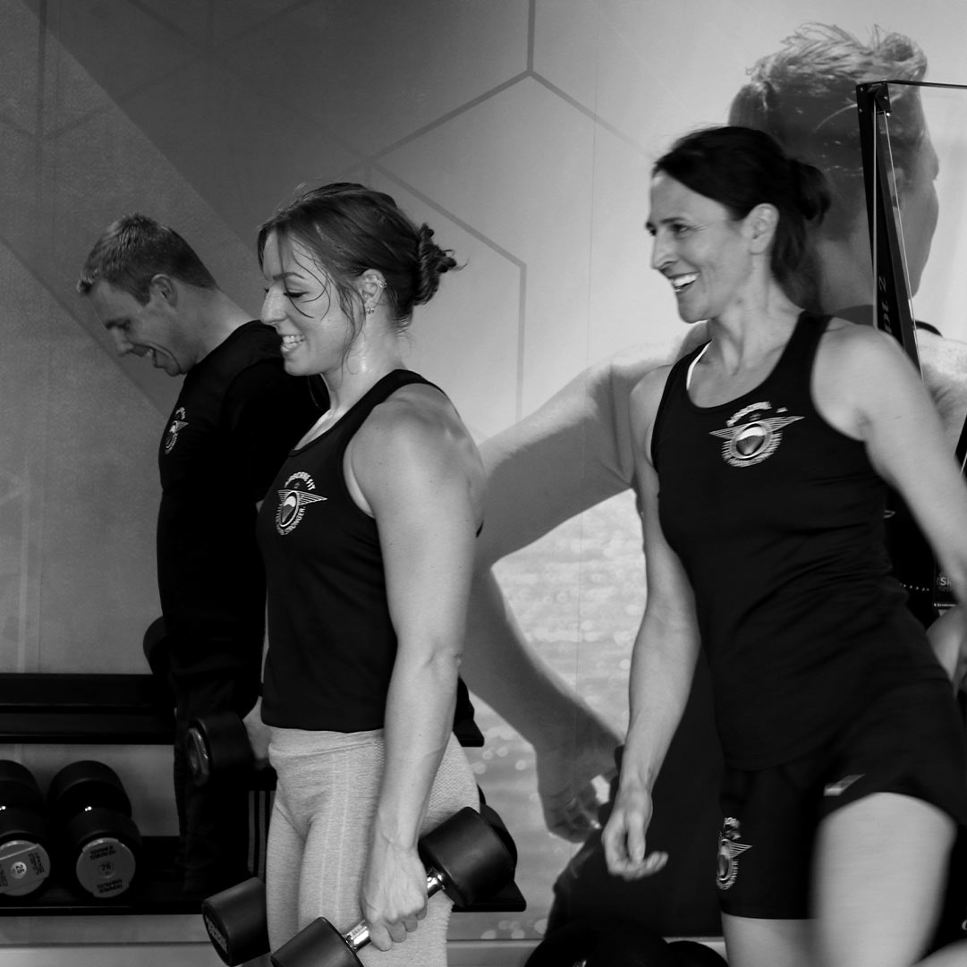 A man and two women in Airborne Fit sportswear lifting weight at the gym in Brightwell
